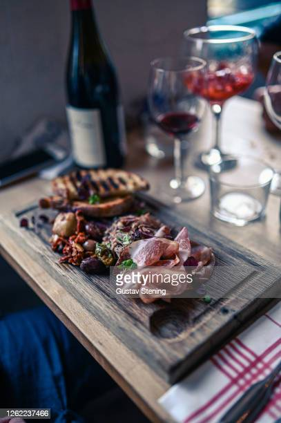 charcuterie board - antipasto stock pictures, royalty-free photos & images