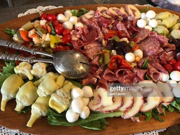 Charcuterie plate mixed with cheese and vegetables