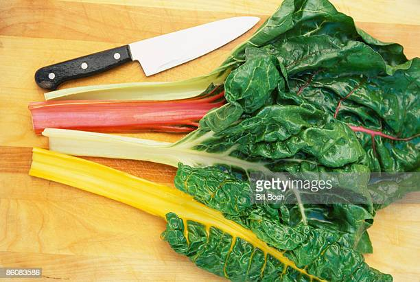 Chard and knife on cutting board