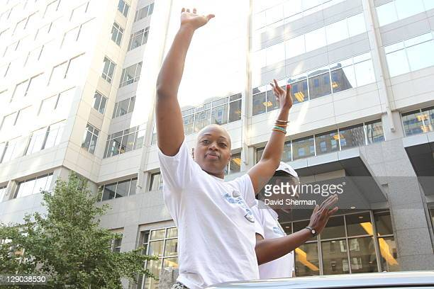 Charde Houston and Amber Harris of the 2011 WNBA Champions Minnesota Lynx wave to the crowd during the Minnesota Lynx Championship Parade through...