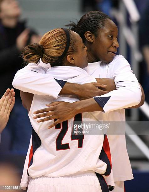 Charde Houston with 16 points and Tina Charles with 22 points celebrate their victory during the NCAA Tournament second round game at the Hartford...