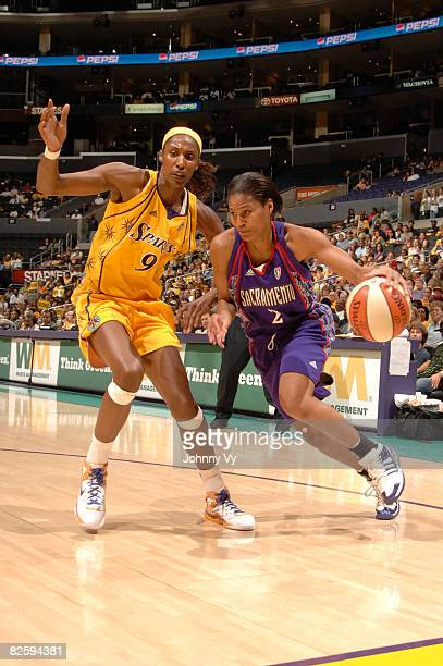 Charel Allen of the Sacramento Monarchs drives along the baseline against Lisa Leslie of the Los Angeles Sparks during their game on August 28 2008...