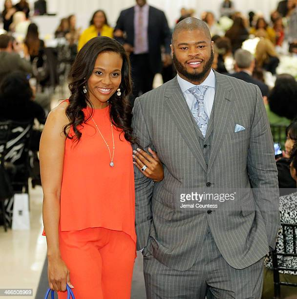 Chareta Smith and Wade Smith walk the runway at the Saks Fifth Avenue And Off The Field Players' Wives Association Charitable Fashion Show on January...