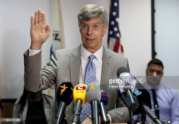 US Charge d'Affaires ai in Ukraine Ambassador William Taylor reads out an oath for 10 Peace Corps volunteers who will join NGOs and academic...