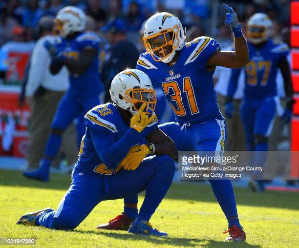 Chargers Desmond King left celebrates his sack with Adrian Phillips at StubHub Center in Carson on Sunday December 3 2017