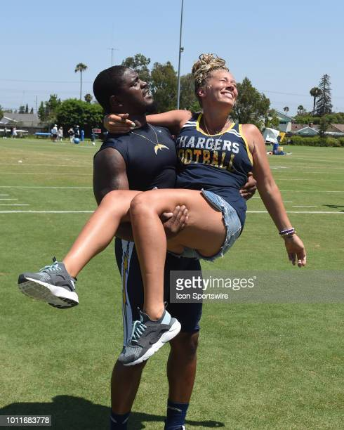 Chargers Linebacker 52 and finance Cassie Stuart having some fun during the Los Angeles Chargers Training Camp on August 03 2018 at the Jack Hammett...
