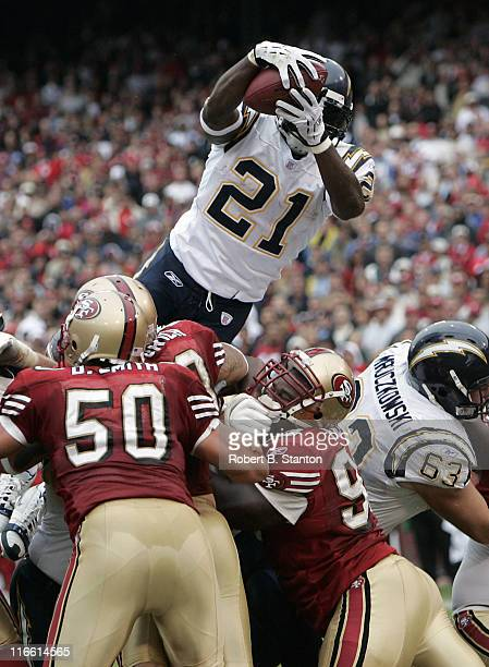 Chargers running back LaDainian Tomlinson lauches up for a 1yard touchdown late in the second quarter as the San Diego Chargers defeated the San...