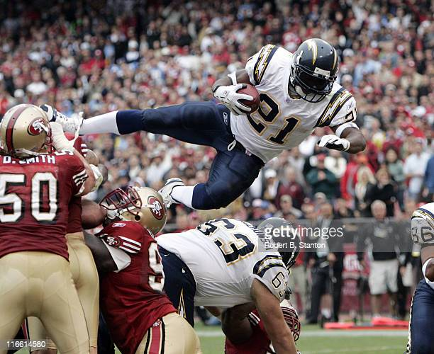 Chargers running back LaDainian Tomlinson scores his third touchdown of the day with a 1yard leap into the endzone late in the second quarter as the...