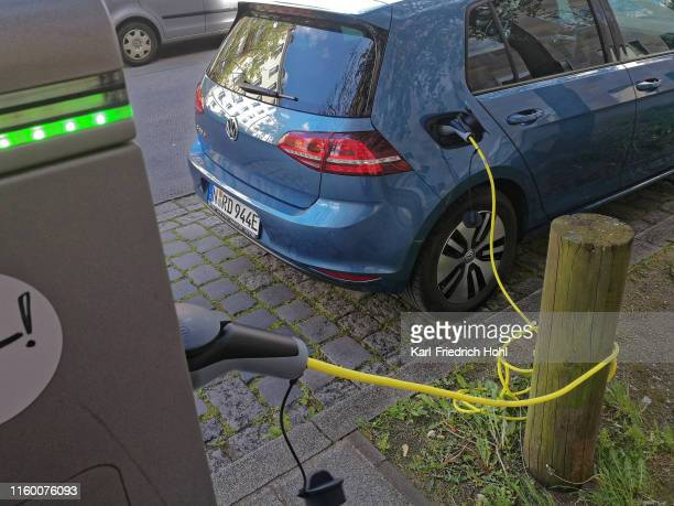 charging a volkswagen golf electric car - alternative fuel vehicle stock pictures, royalty-free photos & images