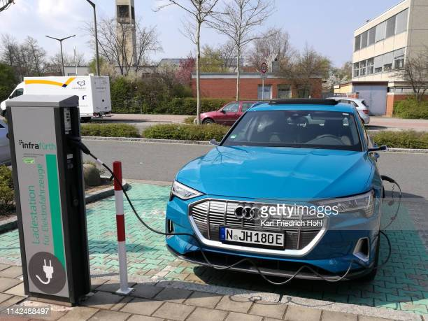 charging an electric car - audi e-tron - audi stock pictures, royalty-free photos & images