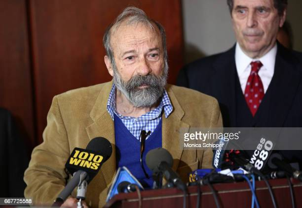 'Charging Bull' statue artist Arturo Di Modica speaks at a press conference addressing legal rights over the 'Fearless Girl' installation on Wall...