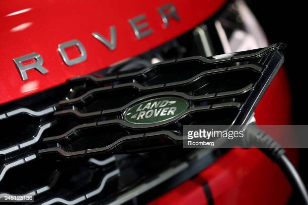 A charging cable is connected to the Jaguar Land Rover Automotive Plc Range Rover P400E HSE Dynamic PlugIn Hybrid sport utility vehicle at the EV...