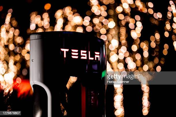 Charging column of the automotive manufacturer Tesla is pictured on November 30, 2020 in Berlin, Germany.