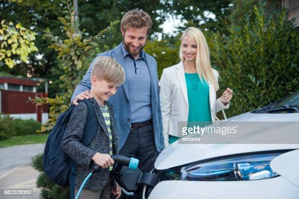 charging electric car - electric vehicle charging station stock photos and pictures