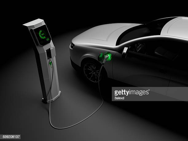 charging electric cars - electric vehicle charging station stock photos and pictures