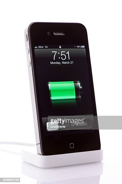 Charging iPhone 4 and usb cable isolated