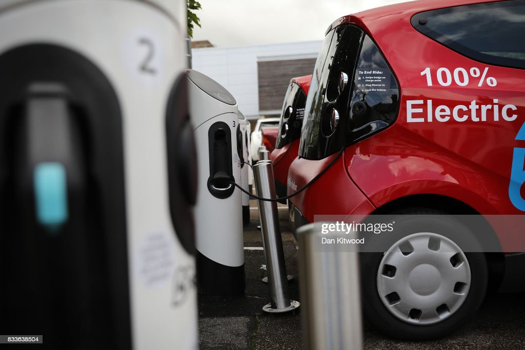 A charging plug connects an electric vehicle (EV) to a charging station on August 17, 2017 in London, England. A study commissioned by power generation company Drax shows that current electric car models are twice as green as they were five years ago.