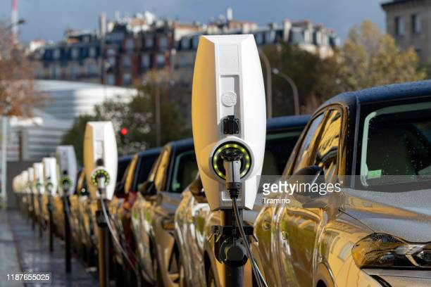 charging points in a row on a street - electric vehicle stock pictures, royalty-free photos & images