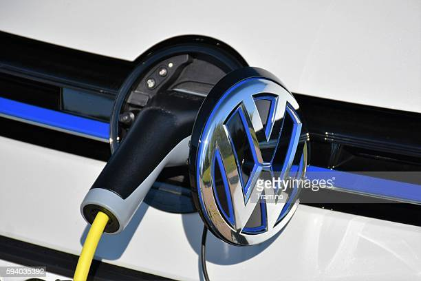 charging process in a modern volkswagen golf gte - volkswagen stock pictures, royalty-free photos & images