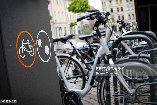 A charging station for ebikes stands next to a bicycle rack on the market square of Pirna on October 02 2016 in Pirna Germany