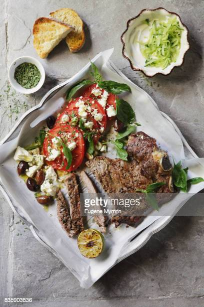 Char-grilled beef steak with herbs, tomato and feta salad