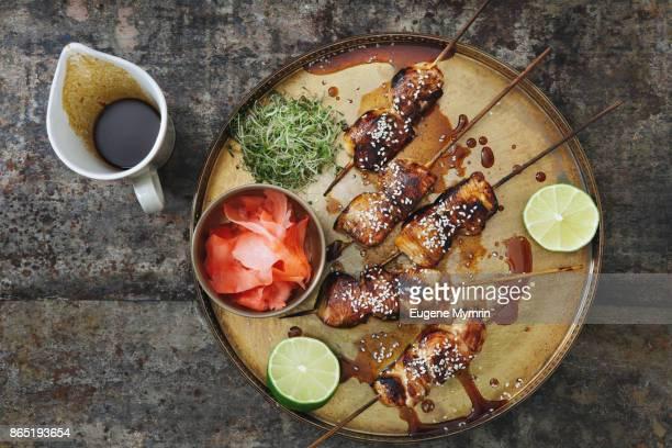 char-grilled yakitori skewers - タレ ストックフォトと画像