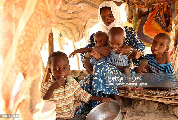 Charifatou feeds her malnourished children at the Mangaize refugee camp in Niger May 21 2012 The family fled Mali to escape the civil conflict
