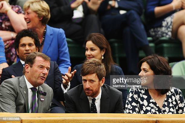 Chariman Philip Brook talks with Sir Bradley Wiggins and his wife Catherine in the royal box on centre court on day six of the Wimbledon Lawn Tennis...