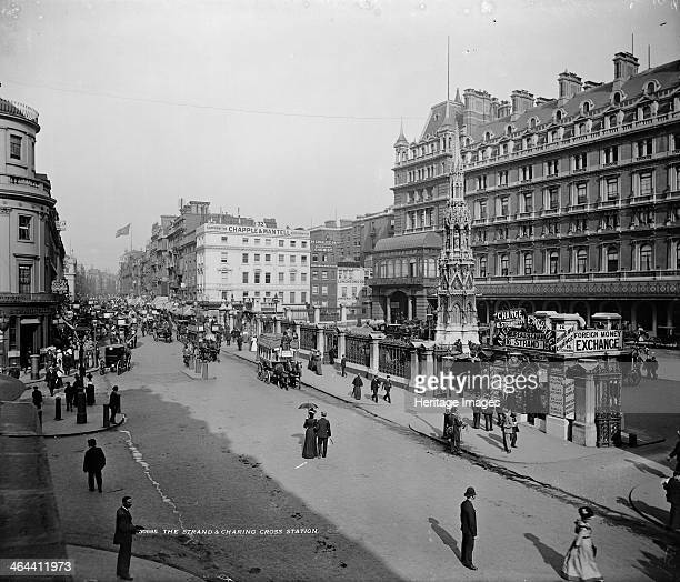 Charing Cross Station and Hotel looking northeast down the Strand after 1881 The Eleanor Cross can be seen in the courtyard A bureau de change stands...