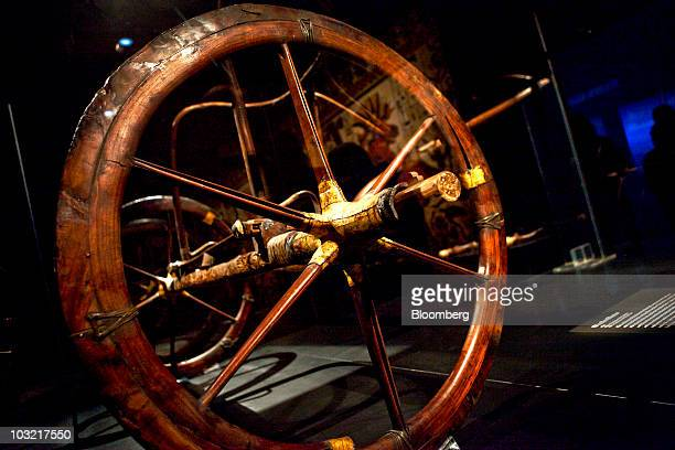 A chariot once owned by Tutankhamun the boy pharaoh who ruled Egypt more than 3300 years ago sits on display during its firstever unveiling abroad at...
