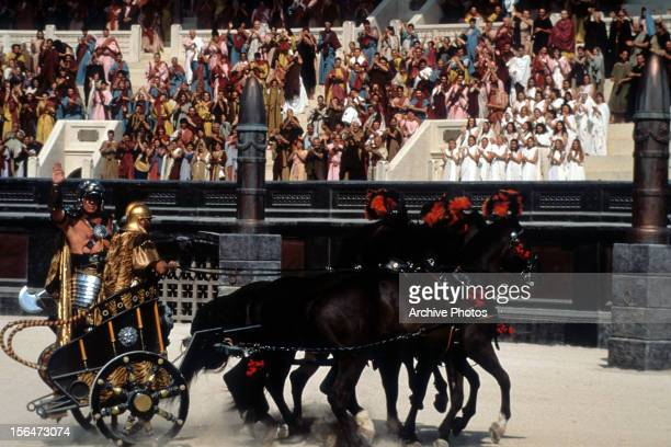 Chariot riding into arena in a scene from the film 'Gladiator' 2000