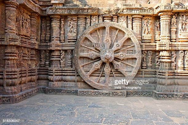 chariot wheel at konark - chariot wheel stock photos and pictures