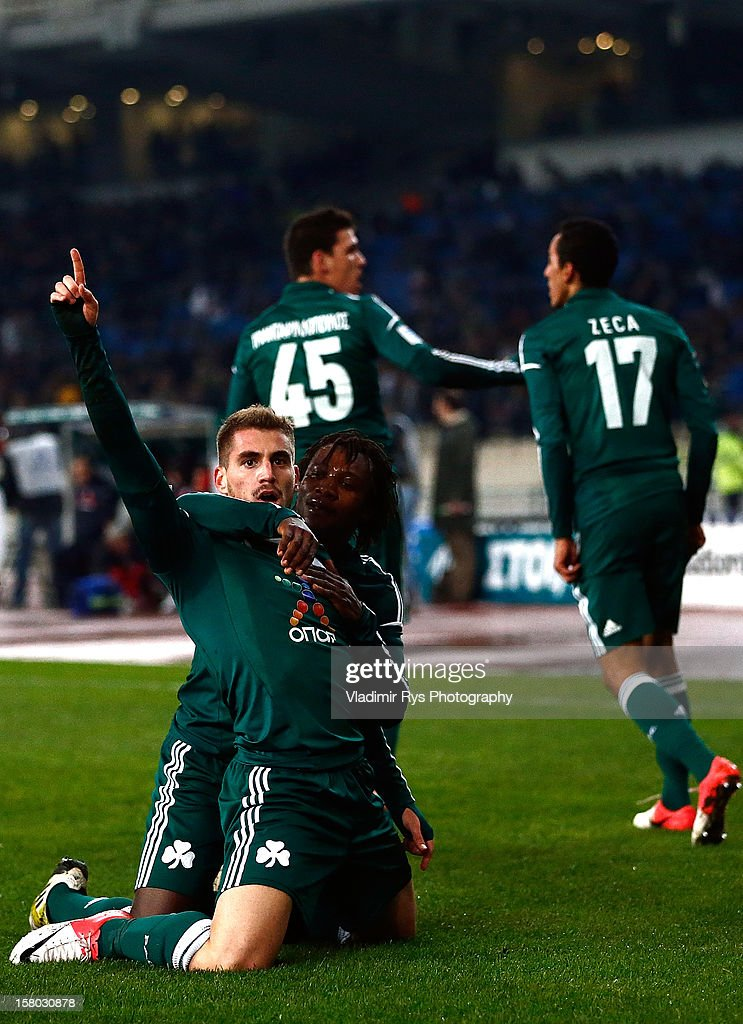Charis Mavrias of Panathinaikos is celebrated by his team mates after scoring his team's first goal during the Superleague match between Panathinaikos FC and Olympiacos Piraeus at OAKA Stadium on December 9, 2012 in Athens, Greece.