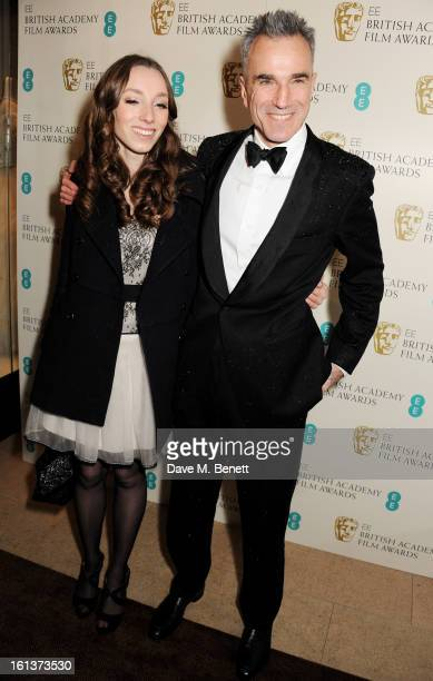 Charissa Shearer and Daniel Day Lewis arrive at the EE British Academy Film Awards at the Royal Opera House on February 10 2013 in London England