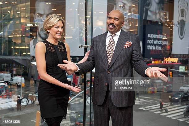 Charissa Thompson interviews Steve Harvey during his visit to Extra at their New York studios at HM in Times Square on February 9 2015 in New York...