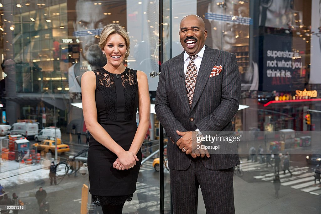 Charissa Thompson (L) interviews Steve Harvey during his visit to 'Extra' at their New York studios at H&M in Times Square on February 9, 2015 in New York City.