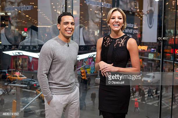 Charissa Thompson interviews Victor Rasuk during his visit to Extra at their New York studios at HM in Times Square on February 9 2015 in New York...