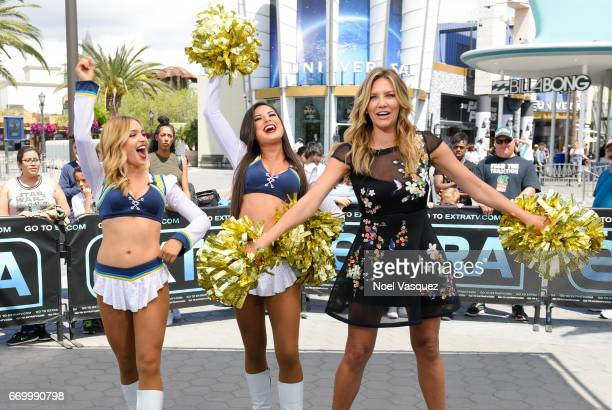 Charissa Thompson poses with the Los Angeles Chargers visits Extra at Universal Studios Hollywood on April 18 2017 in Universal City California