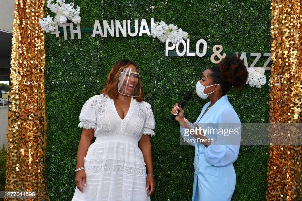 Charisse Jordan of Real Housewives of Potomac is interviewed by Bblue carpet media host Ambreia Williams at Grandiosity Events 4th annual Polo & Jazz...