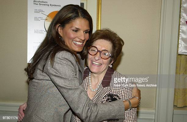 Charisse Strawberry hugs Adele SmithersFornaci president of the Christopher D Smithers Foundation during news conference at the WaldorfAstoria...