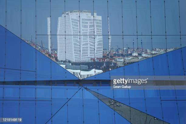 Charite Hospital Berlin's biggest hospital stands reflected in the glass facade of an office building on March 27 in Berlin Germany The coronavirus...