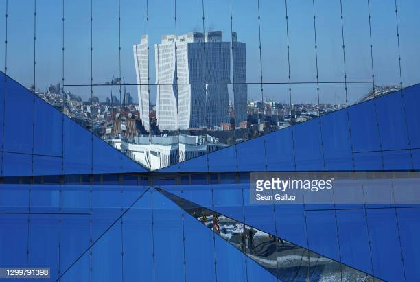 Charite Hospital stands reflected in various panes of glass of an office building during the second wave of the coronavirus pandemic on January 31,...