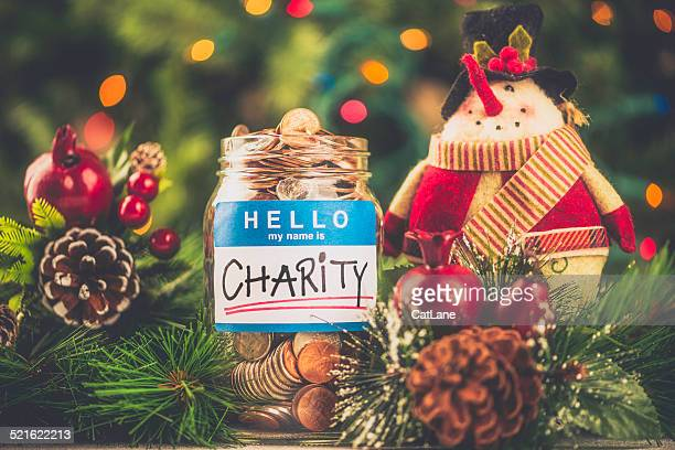 Charity donation jar filled with American currency in holiday setting