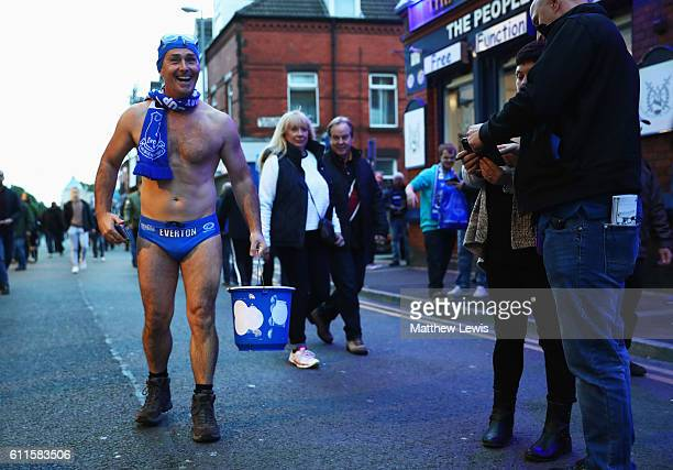 Charity fundraiser and Everton fan Michael Cullen AKA Speedo Mick collects donations outside the stadium prior to the Premier League match between...