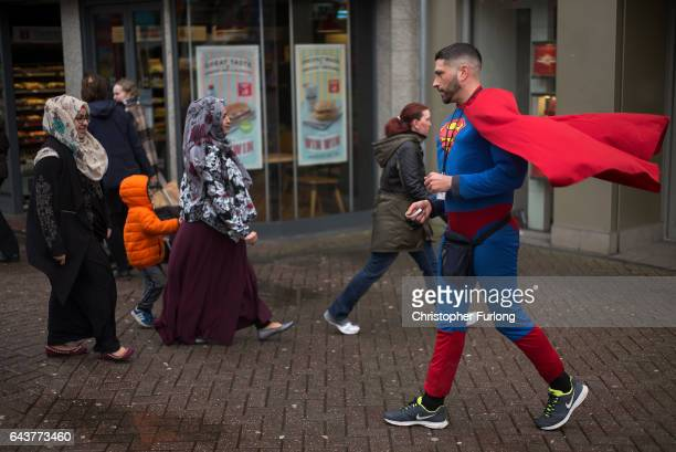 A charity fundraiser dressed as Superman walks through Hanley on the last day of campaigning by candidtates in the Stoke Central byelection on...