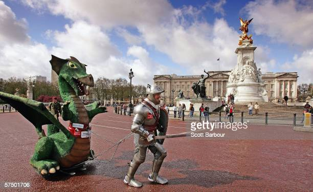 Charity fundraiser Lloyd Scott dressed in a full suit of armour weighing 100 pounds and dragging a 10 foot dragon weighing 200 pounds runs past...