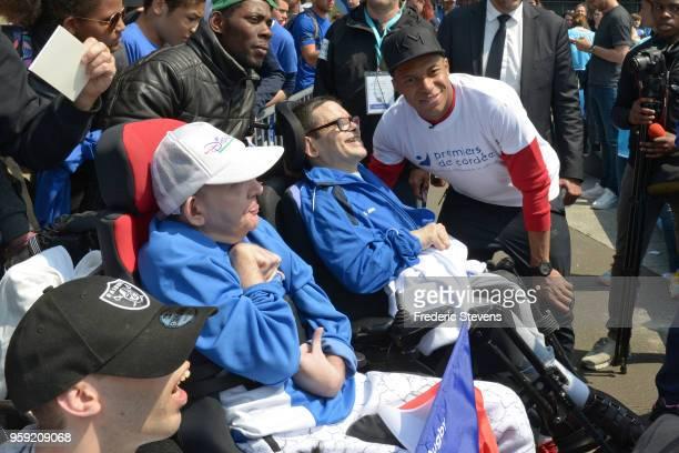 Charity godfather Paris Saint Germain footballer Kylian Mbappe takes part in the 'Tous En Bleu' sports workshops organised by the charity 'Premiers...