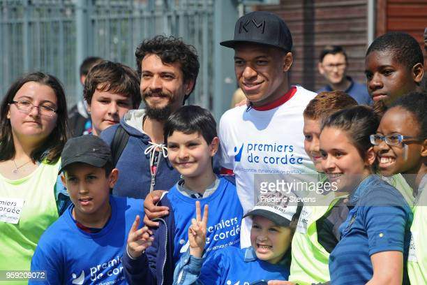 Charity godfather Paris Saint Germain footballer Kylian Mbappe takes part in the 'Tous En Bleu' sports workshops organised by the charity 'Premiers...
