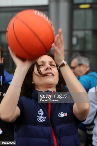 Charity 'godfather' the former figure skating champion Nathalie Pechalat take part in the 'Tous En Bleu' sports workshops organised by the charity...