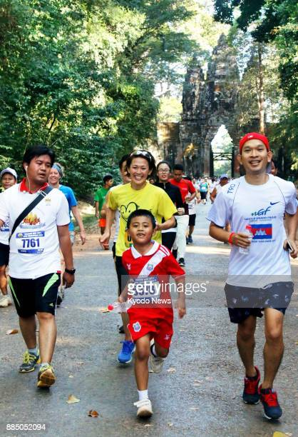 A charity half marathon that raises funds for landmine victims in Cambodia is held on Dec 3 2017 in the country's temple city of Angkor Wat with...